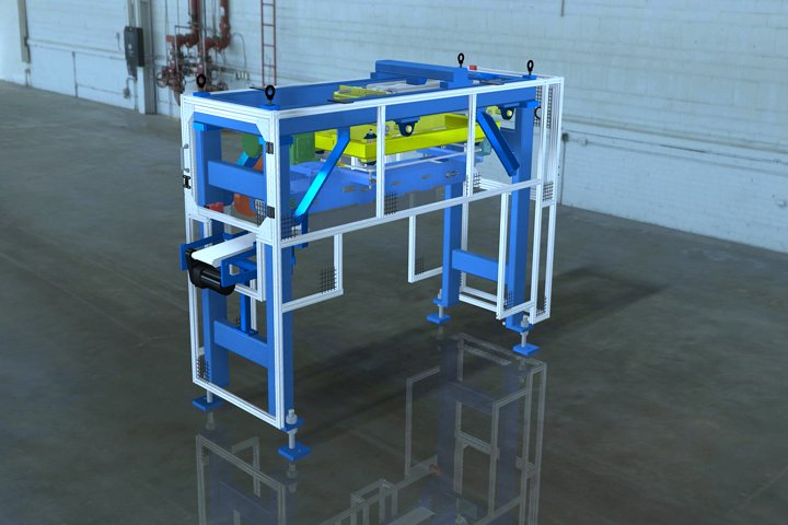 Backside view of the Model 366 Magnetic Furnace Unloader. Notice the integrated transfer conveyor shown on the left. This belt conveyor is height adjustable providing a smooth transfer of parts from the magnetic conveyor to an optional take-away conveyor.