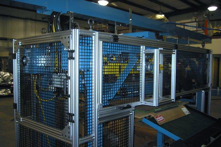 Model 366 Magnetic Furnace Unloader front corner view. Note: Sinter plate handling conveyor is shown in front of the Model 366 Magnetic Furnace Unloader.