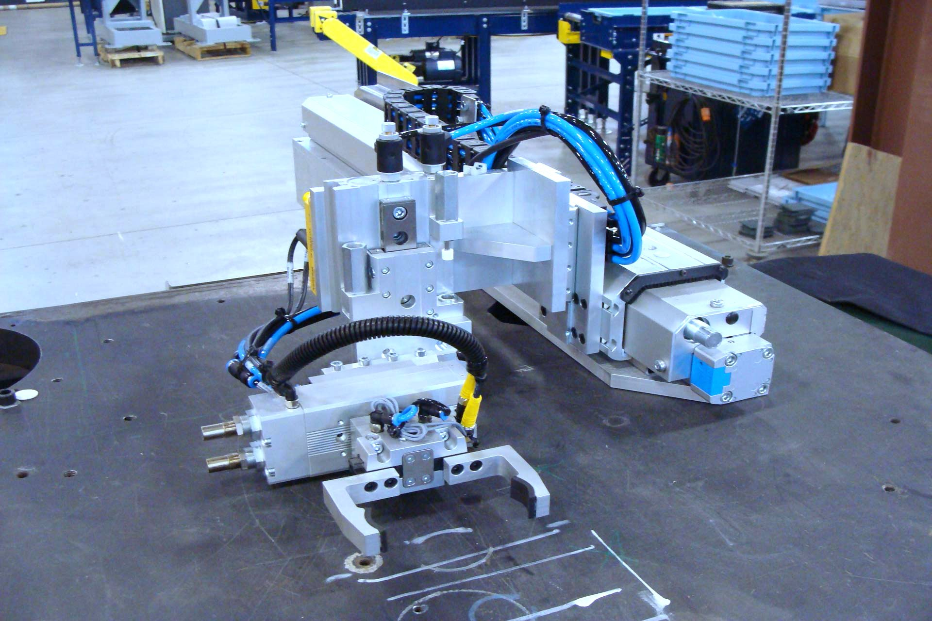 Model MA Press Takeout parallel gripper, pneumatic rotary and Z lift unit. These components function together providing the ability for multiple motion profiles such as: pick/retract/place, pick/lift/retract/lower/place and pick/lift/retract/flip 180/lower/place.