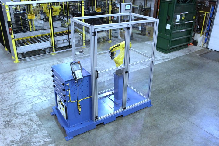 Model MD MiniDrawer ™ Cabinet integrated with a FANUC LRMate 200iD/7L and mounted to a common skid complete with Lexan/Aluminum cell guarding. This is referred to as a Model MD7L machine tender. This cell may be configured to tend one or two CNC machine tools, such as small lathes, mills or other similar machines.