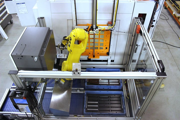 Top view of the Model RMT Machine Tender. Note: The orange pneumatic Auto Door in the background. The Auto Door enables quick access into and out of the machine tool.