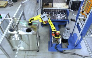 FANUC M-10iA robot tending a lathe mockup. Raw parts are introduced into the system using a 3 drawer MT Series drawer cabinet. Parts are processed in the lathe, unloaded and cleaned (removal of chips and coolant) in a MiJet blow off station and then fully cleaned in a top-load wash/dry system. For faster load/unload times, the robot enters and exits the lathe through an ACE AutoDoor mounted to the front of the lathe. Once fully processed, the parts are then placed back into the MT Series Drawer cabinet.