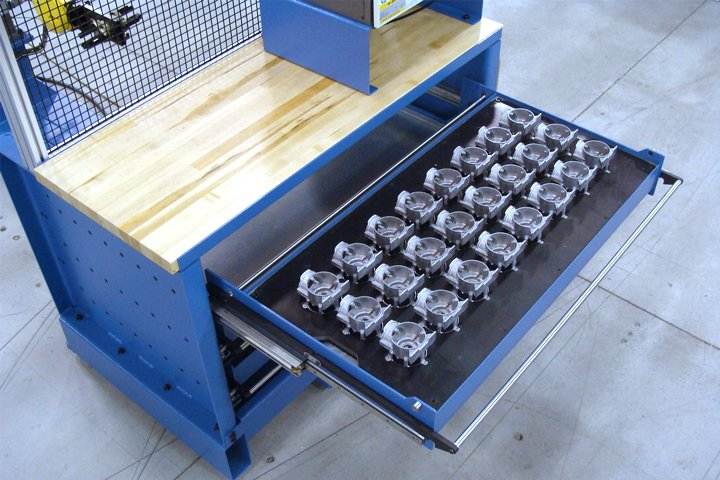 """Front left view of the Model MT Series Integrated Machine Tender. Note: The MT Series Drawer Cabinet includes 3 Drawers (4 Drawers are an available option) with a large 48"""" W x 24"""" D x 6"""" H part fixture area."""