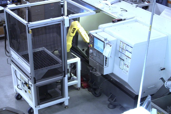 RoboCart with a single drawer and a FANUC LR Mate 200iD/7L robot with dual end of arm tooling integrated to a CNC lathe. The side safety door is shown in the open position allowing the operator to easily access the chuck in the lathe for setup purposes.