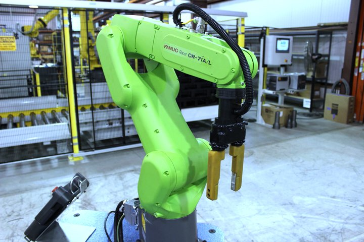 FANUC CR-7iA/L collaborative robot used on the CBOT Collaborative Robot Cell. Notice the green color of the collaborative robot makes it different from the normal FANUC yellow non-collaborative industrial robots.
