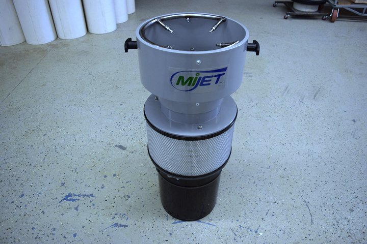 """Robot friendly 8"""" MiJet part cleaner with and oversized top and integrated nozzle array. The coolant/chip bucket is shown on the bottom and is easily removed for cleaning with a snap-style clamp."""
