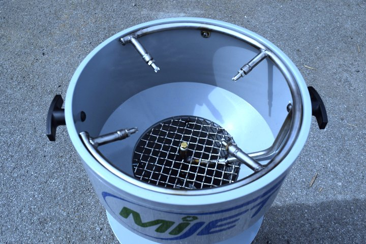 Close up of a MiJet part cleaner with a nozzle array for automating part cleaning with a robot. Note the enclosed screened in area which houses the draw down vacuum unit.