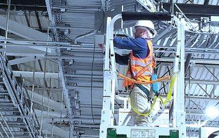 Adaptec technician installing a raised Hytrol EZ Logic 24-volt zero pressure accumulation conveyor