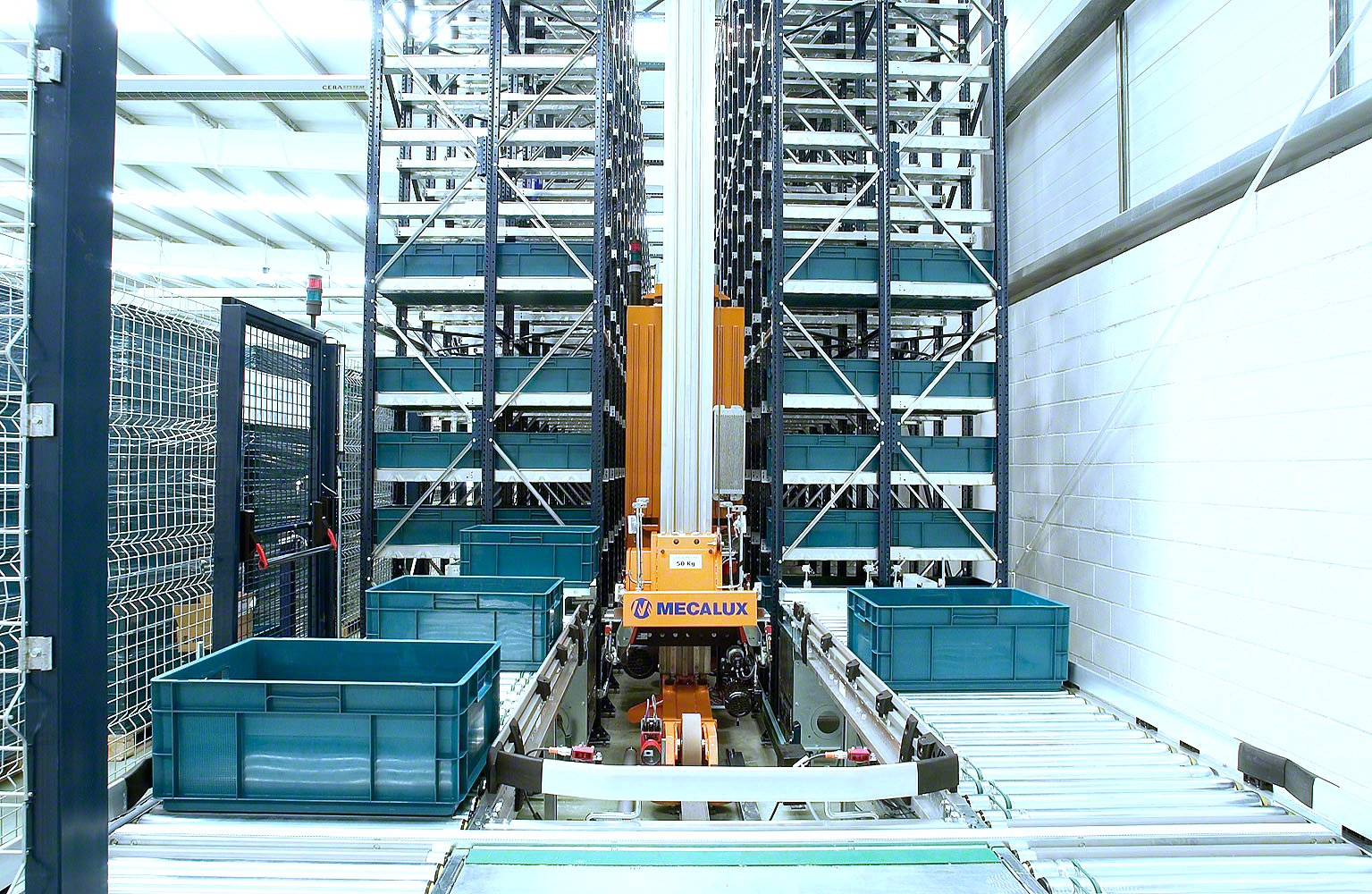 Mecalux stacker crane retrieving boxes for an automated storage and retrieval system ASRS
