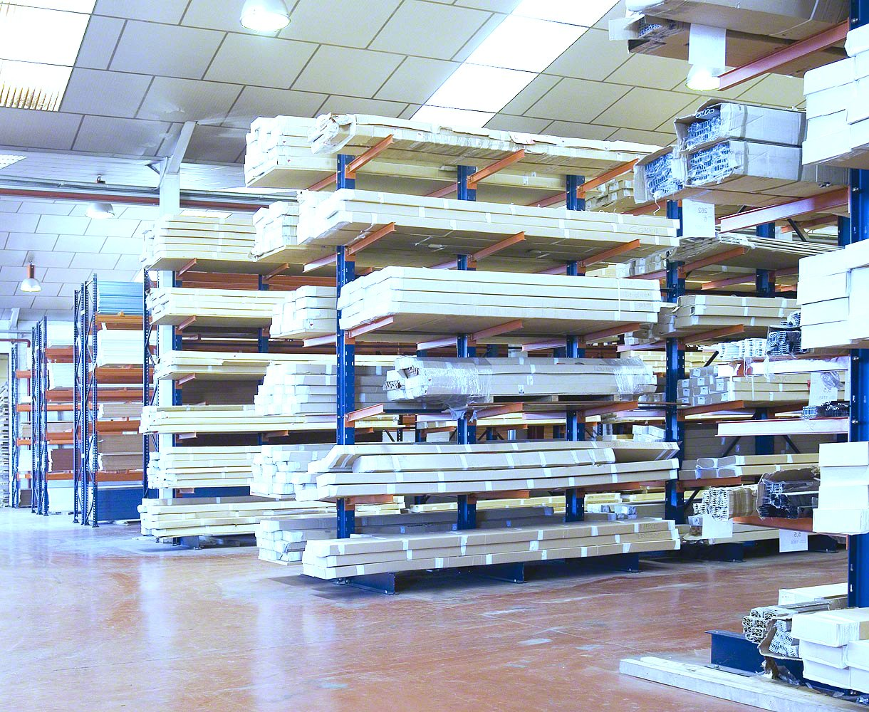 Multiple aisles of Interlake Mecalux Cantilever rack storing wood