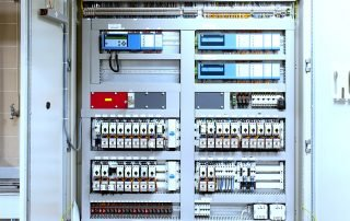Open control panel showing circuitry and swtiches