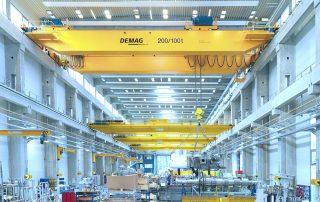 Demag heavy overhead bridge crane in a manufacturing facility