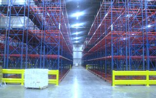 Aisle view separating 2 Interlake Mecalux pallet rack systems