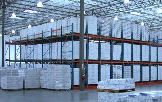 Interlake Mecalux Pallet Flow Rack centralized within a distribution center filled with product being stored