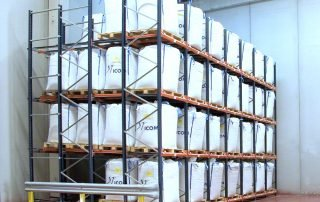 Interlake Mecalux push back pallet rack system filled with product stored in warehouse corner