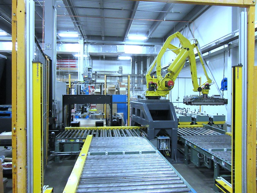 Hytrol pallet handling CDLR outfeed conveyors for a FANUC M-410 robot case palletizing cell