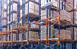 Multiple rows of Selective Pallet rack filled with pallet loads in distribution center.