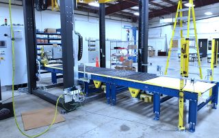 Muller Ring Wrapper over a line of pallet handling CDLR conveyor