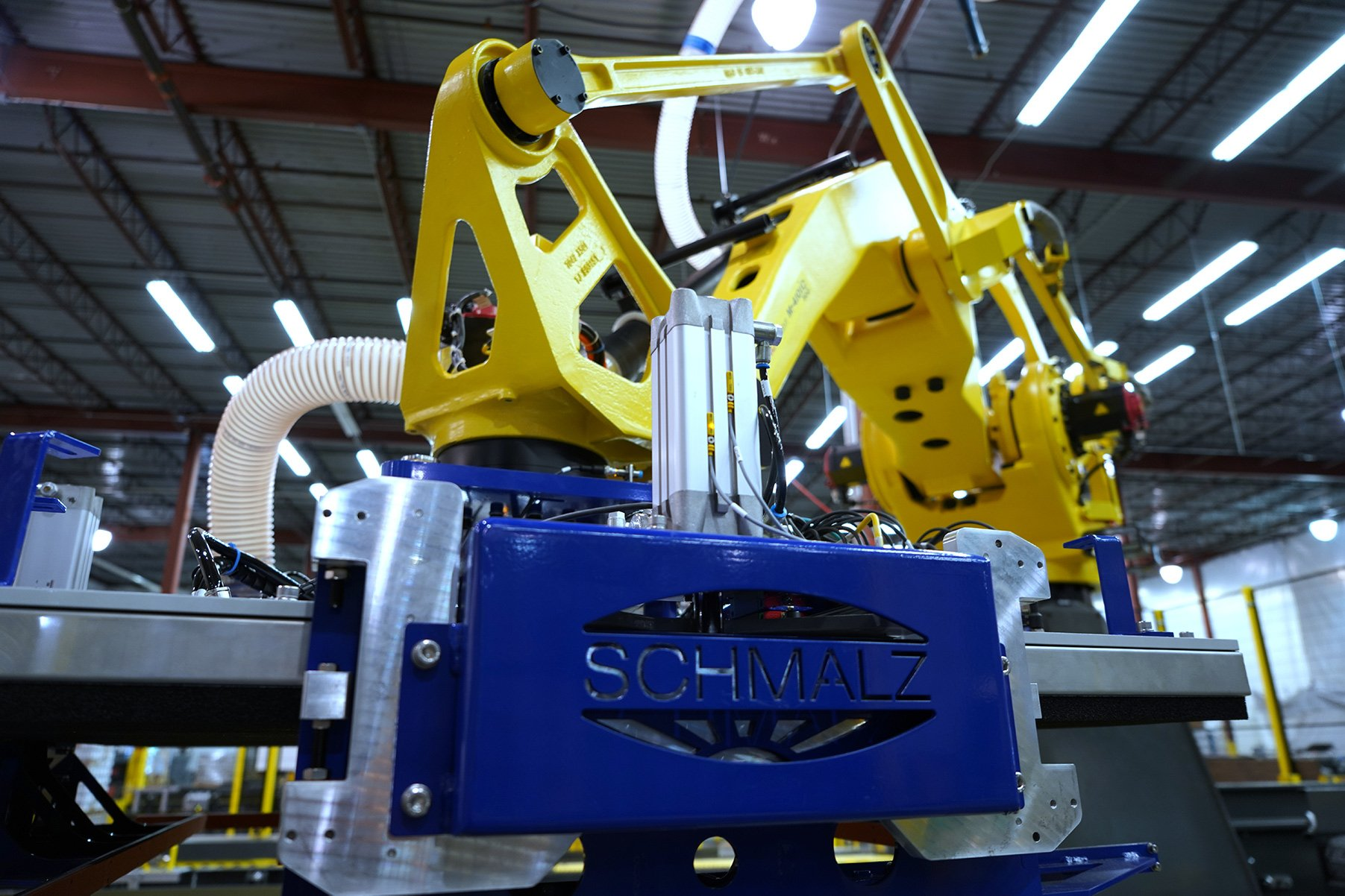 FANUC M-410 Series robot with a Scmalz vacuum custom end tool for a depalletizing system