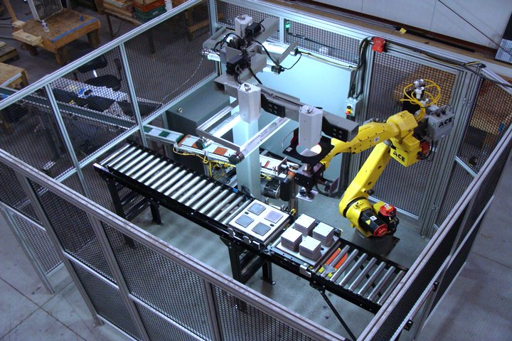 Fanuc M 20iA tray palletizing cell using iRVision