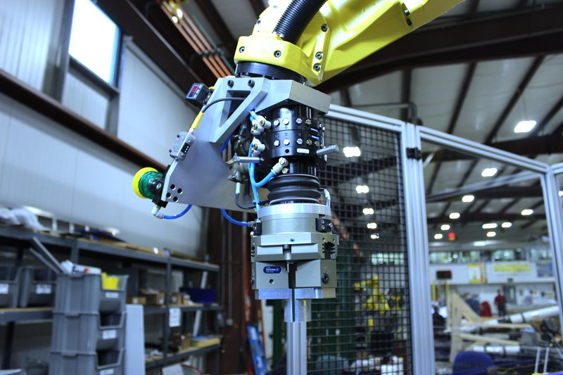 FANUC M-20iA robot with FANUC iRVision and line tracking, Keyence laser sensor used for Z-axis offset, Schunk quick change gripper fingers