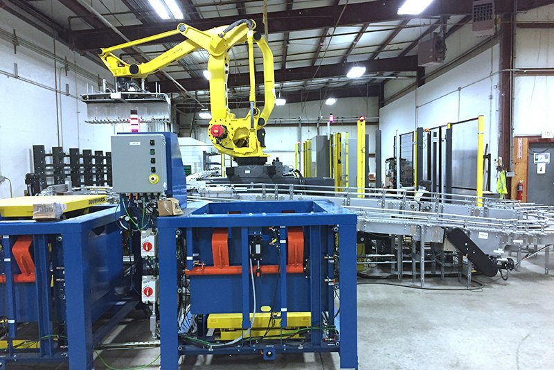 FANUC M-410iB/140H case palletizing robot with Hytrol 138 ACC Conveyors infeed lines and 2 Alba CDLR conveyor for pallet outfeeds