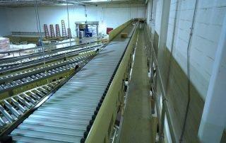 Hytrol Shoe Sortation Conveyor Line diverting packages to multiple Hytrol CDLR conveyor lines