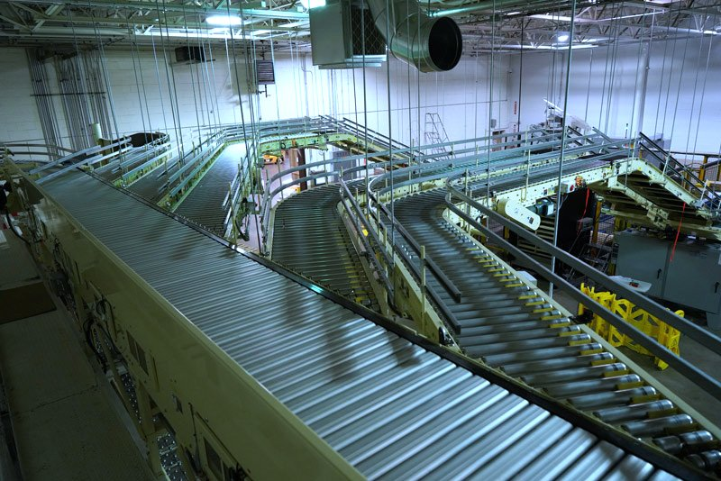 Hytrol Shoe Sortation Conveyor feeding multiple Hytrol CDLR conveyor lines