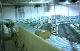 Package on Hytrol Shoe Sorter Conveyor with multiple outfeed lines