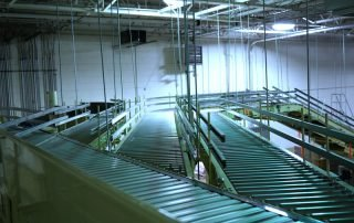 Hytrol Shoe Sorter Conveyor with multiple outfeed lines