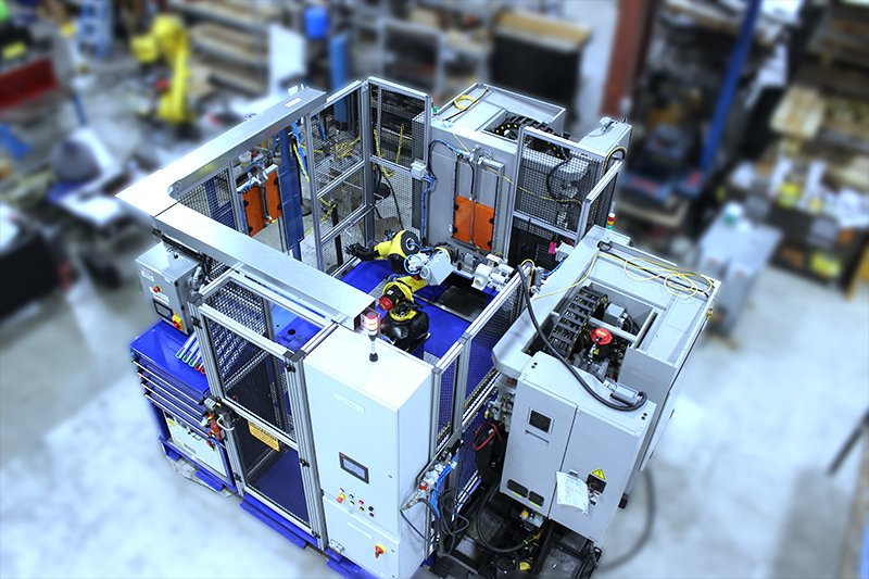 Automated Cell using a FANUC M10iD/12 floor mount robot for part machining along with the Adaptec Model MD MiniDrawer part presentation cabinet with fixtures, Adaptec Auto Doors on mills, Keyence GT gauge and a New Vista servo-controlled thread checker.