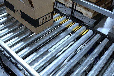 Hytrol Accumulation Minimum Pressure Conveyor with an open cardboard box on the line