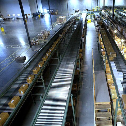 Multiple Lines of Hytrol Accumulation Zero Pressure Conveyor with packages moving on the line