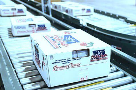 2 Hytrol Accumulation Zero Pressure Conveyor lines with cartons traveling