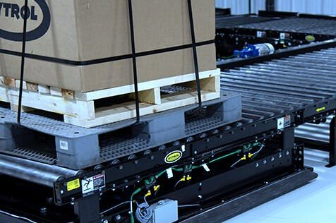 Hytrol Chain Driven Live Roller Conveyor CDLR with loaded pallet exiting the line