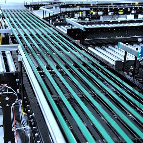Hytrol ProSort Narrow Belt Sorter Close Up wit multiple CDLR lines for diversion