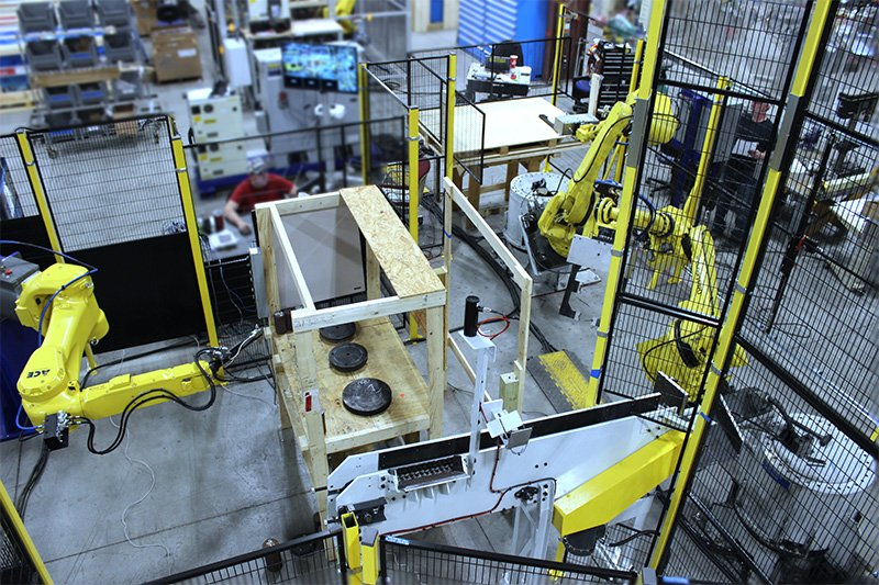 Overhead view of forging automation cell with FANUC M20iB Forging Robot
