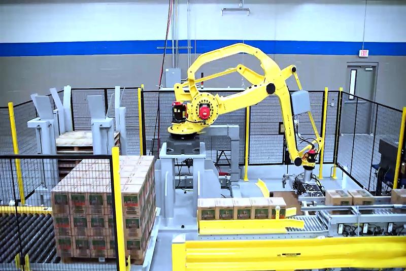 Robot end-of-arm tool picking up slip sheet