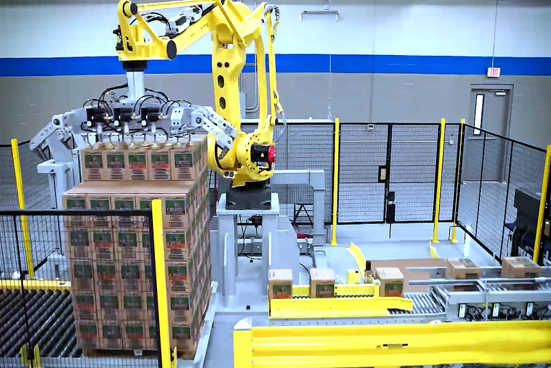 Robotic palletizer placing cases onto stacked pallet