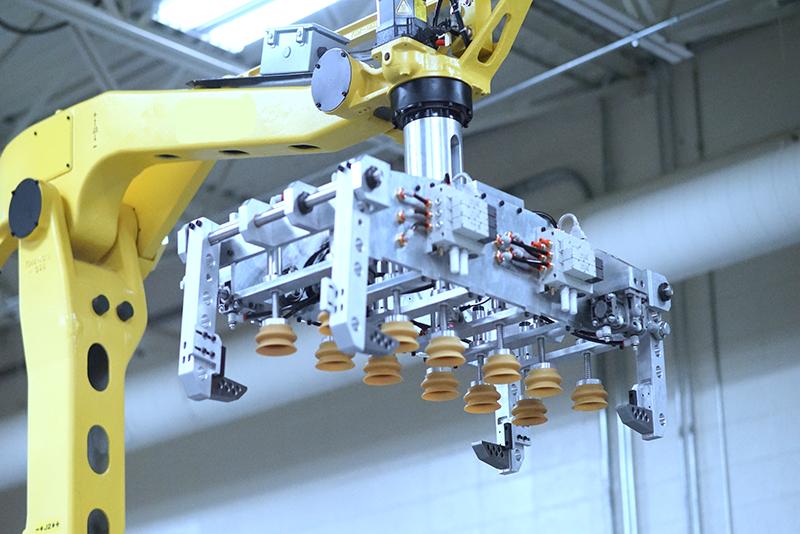 Close up image of vacuum gripper on FANUC robotic palletizer