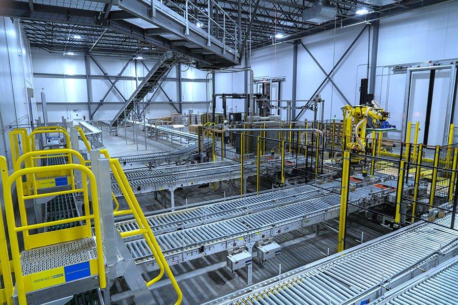 Overhead view of Hytrol conveyor system feeding into robotic palletizing cells