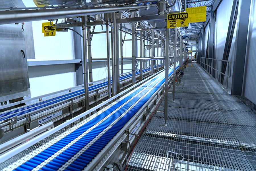 6 lines of SpanTech conveyor leading into the VRT